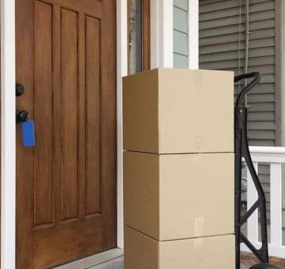 Cardboard-boxes-on-front-porch-of-house