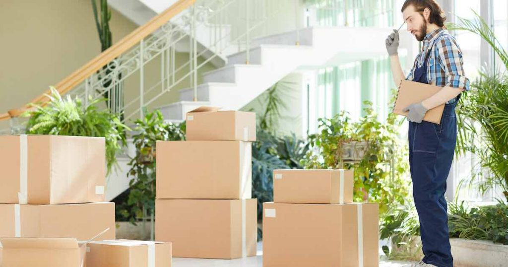 pensive-moving-specialist-counting-delivered-boxes